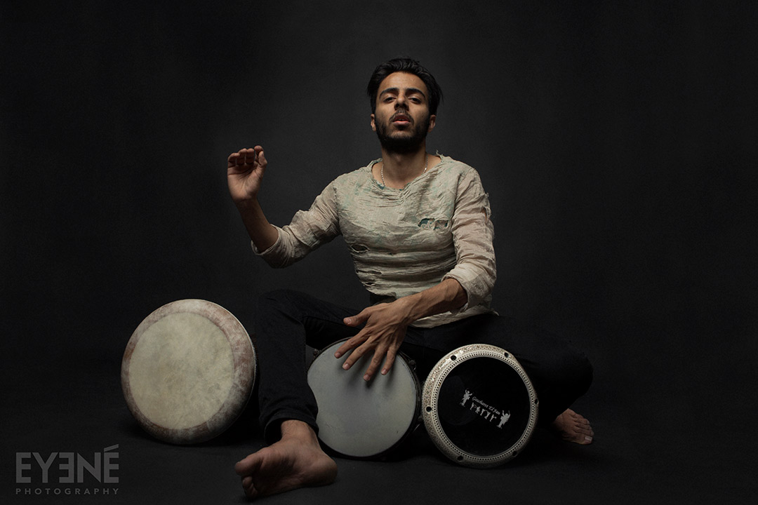 Naghib Shanbehzadeh playing traditional percussion.  Photo: Saman Aghvami/ EYENÉ